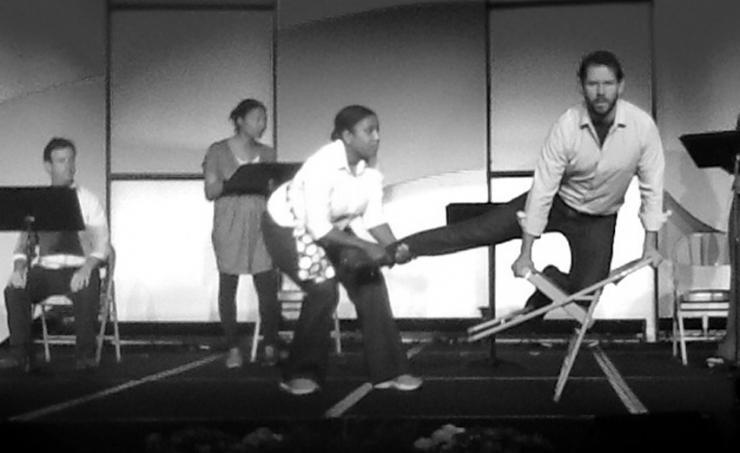 Actors dancing on stage