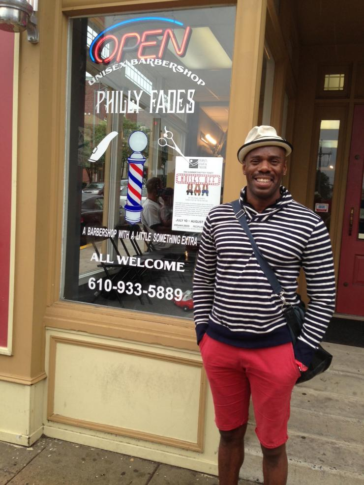Colman in front of a barber shop