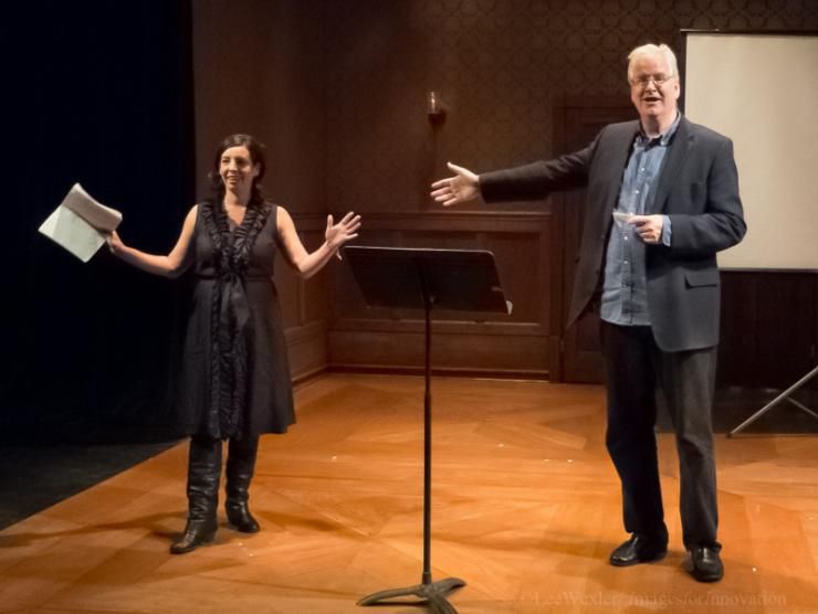 A man and a women on stage gesturing