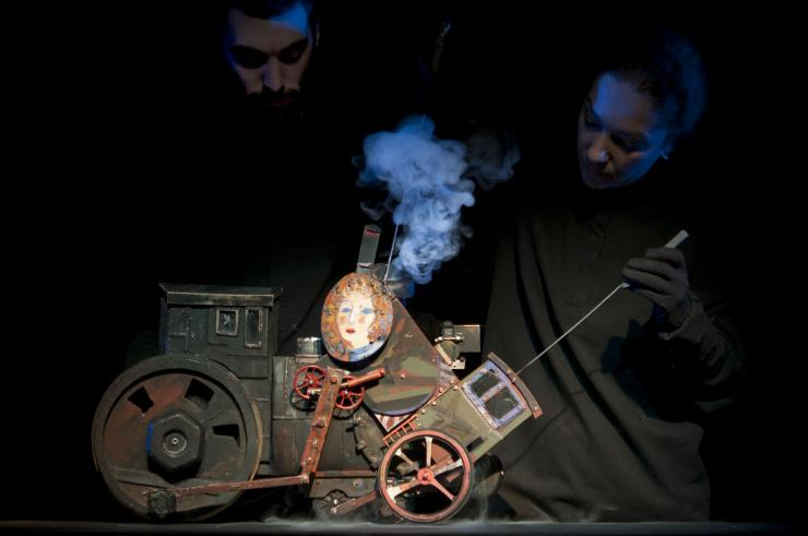 two puppeteers operating a puppet