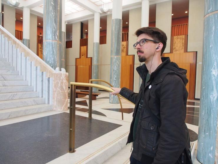 reuben Ingall stands in the parliament house