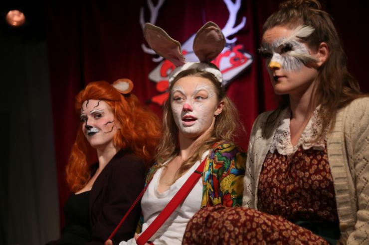Three actors in stage makeup