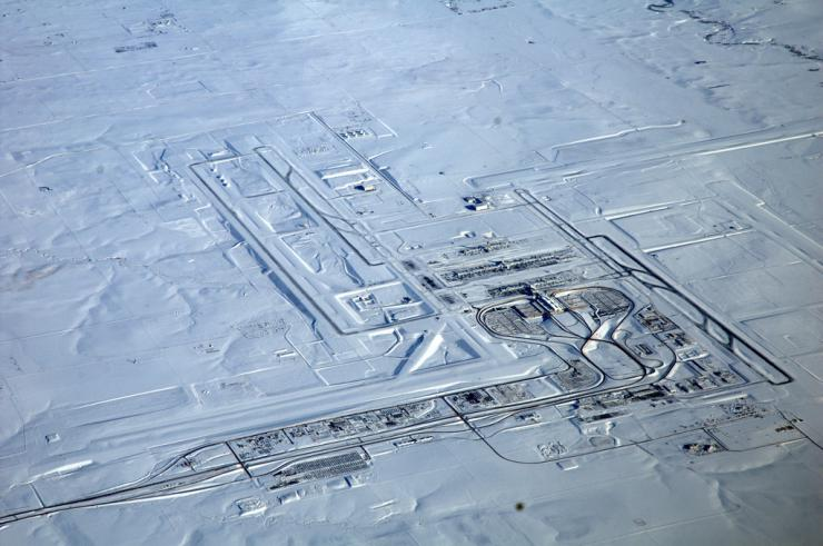 Aerial view of a snow-blanketed airport