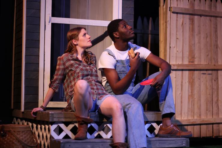 Two actors on a porch set