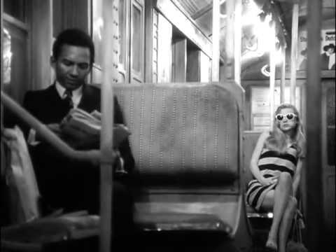 Black man and white woman on a train
