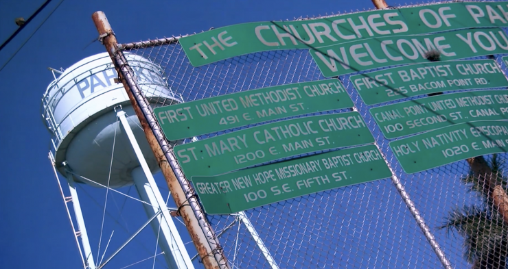 signs for churches on a fence