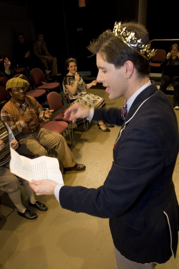 an actor reading a text