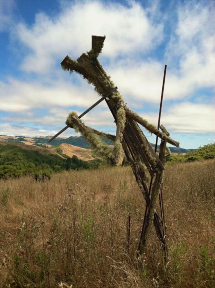 a sculpture in a field