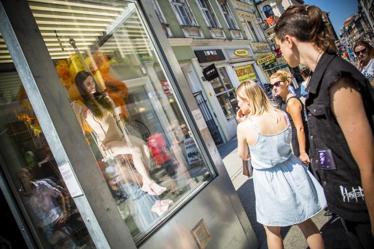 pedestrians watching performance art