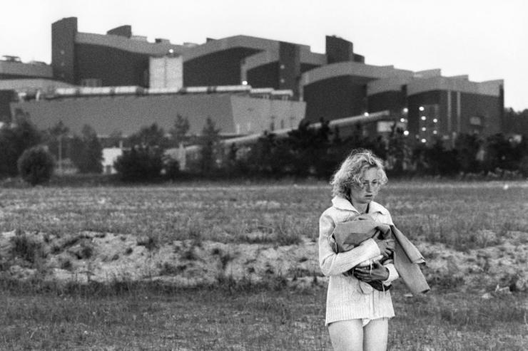woman standing alone in a field
