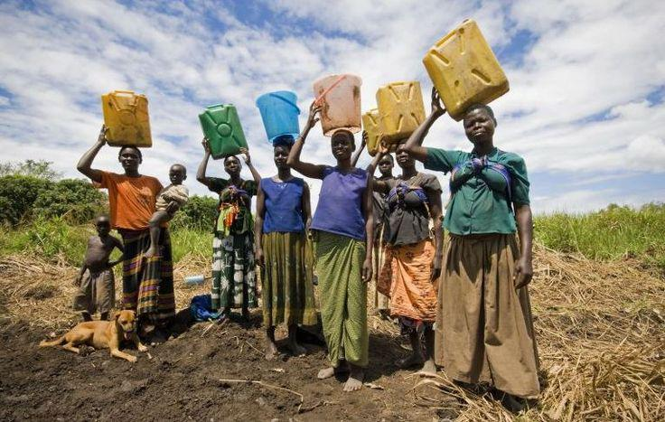 a line of women holding jugs of water