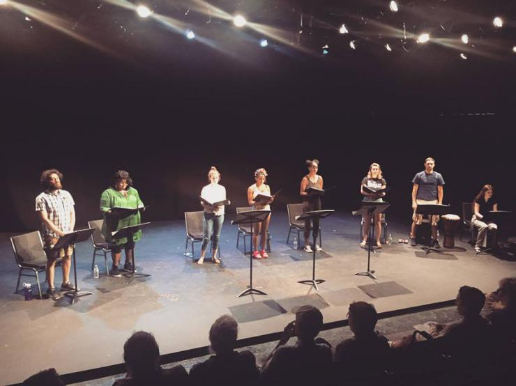 eight performers in a staged reading