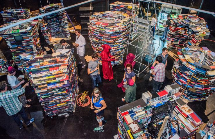 students walk through a book maze