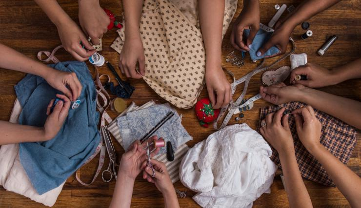 many hands sewing