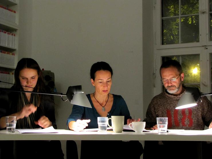 Three actors at a reading