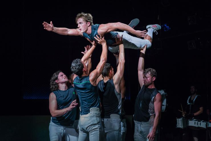 men holding another man in the air