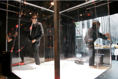 People climbing in a glass box