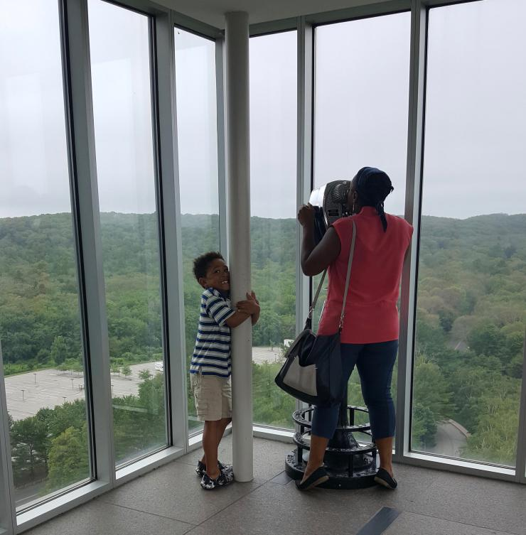 Two people looking out over an Observation Deck.