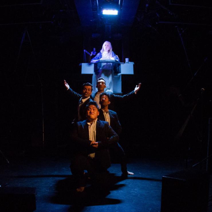 5 performers pose onstage