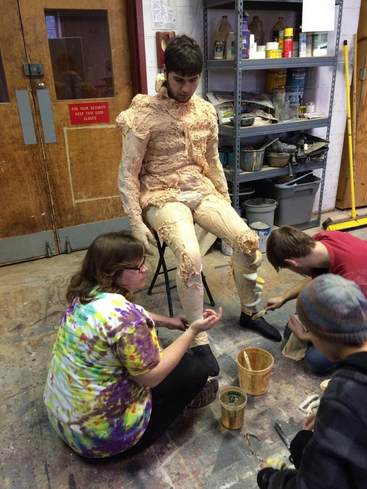 Students working on a cast costume
