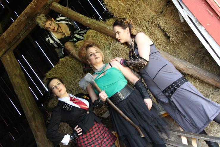 Four actors posing in costume
