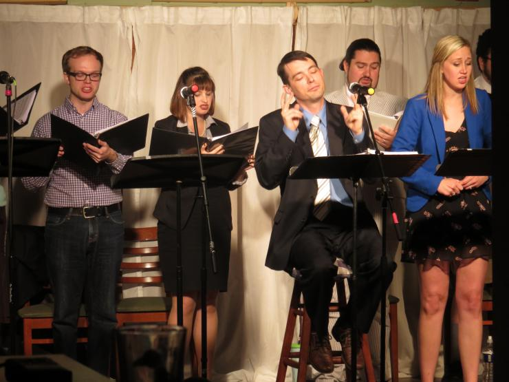 A group of singers performing at a new musicals reading