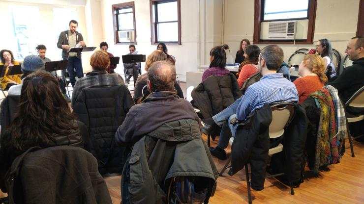 an audience watching a staged reading