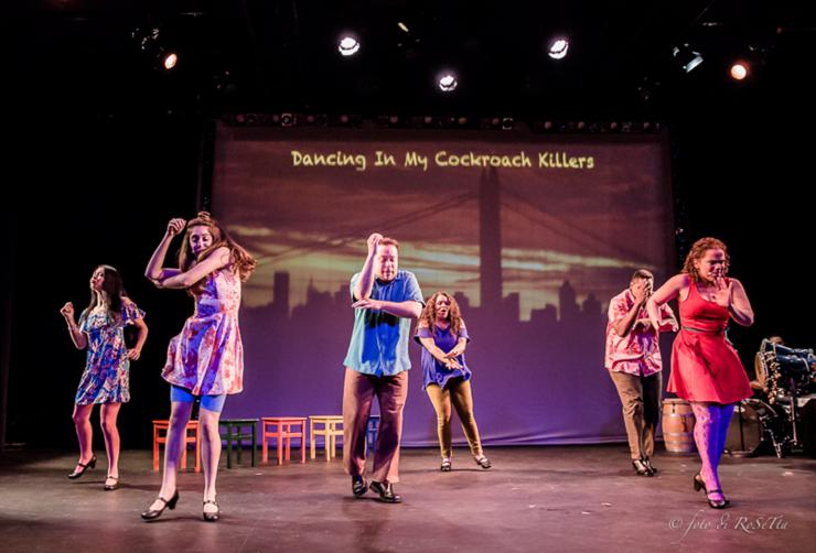 ensemble of actors dancing onstage