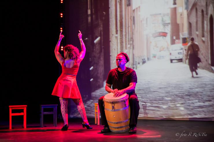dancer and drummer in front of a projection screen
