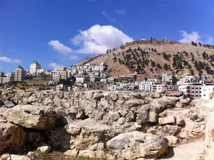 White buildings on a rocky hillside.