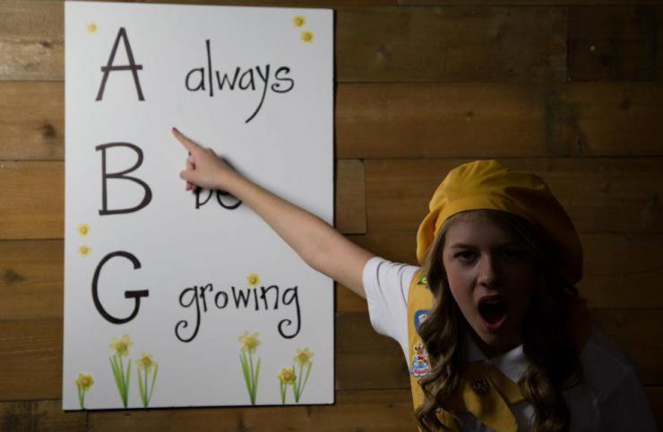 A girl pointing to a sign