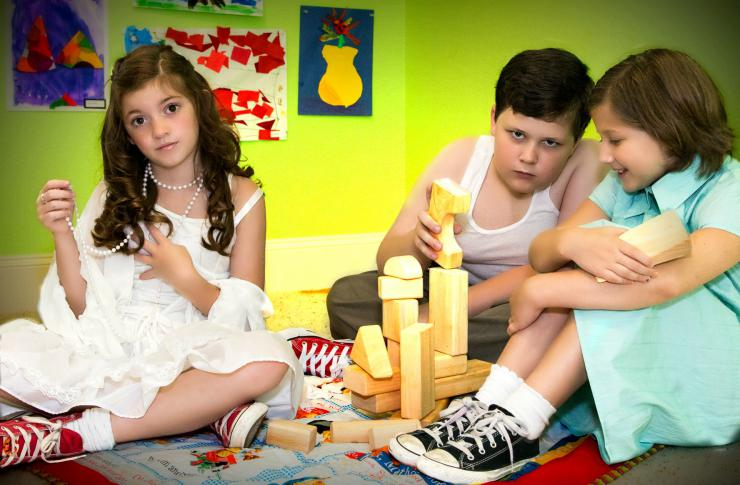 Three children playing with blocks