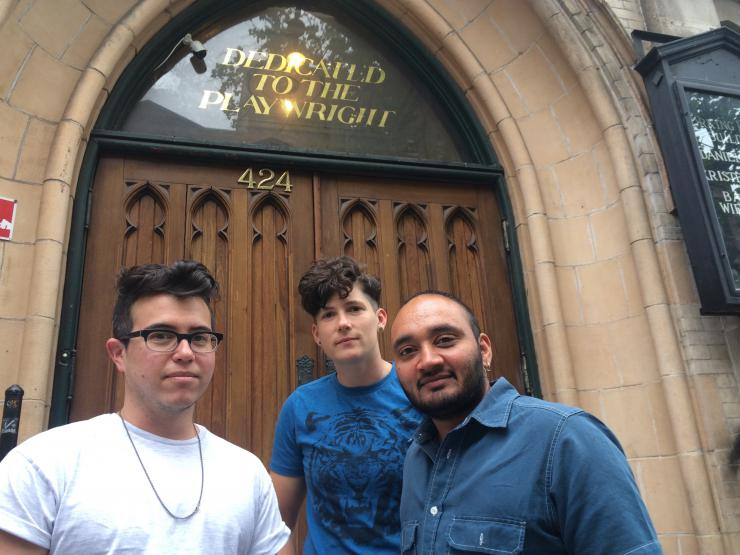 Three playwrights outside a door