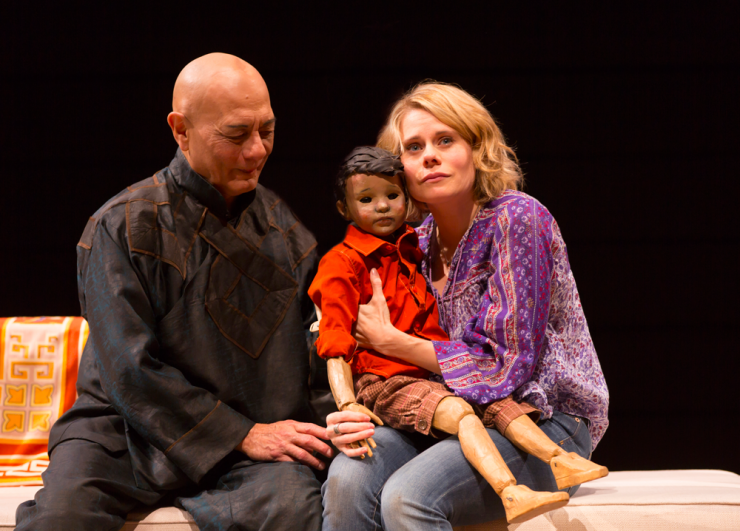 Two actors and a puppet on stage