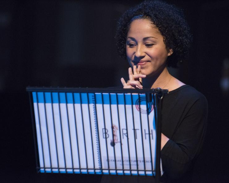 Actor smiling, reads script from music stand