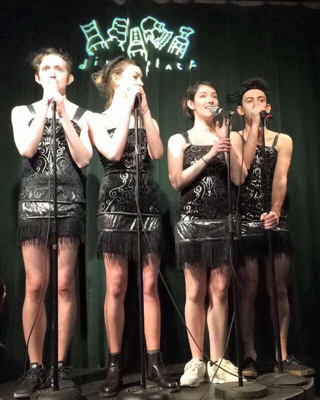 4 performers singing