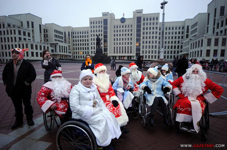 People in wheelchairs and santa costumes