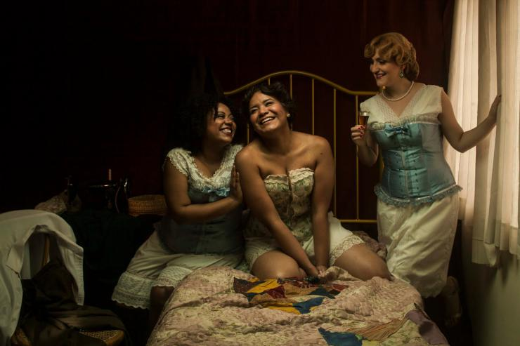 three actors on a bed