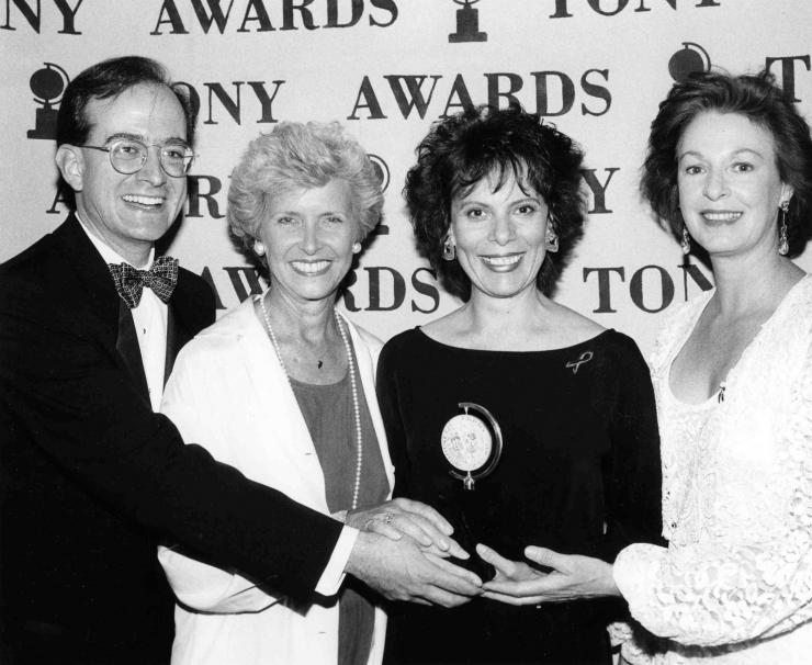 Emily Mann and friends pose with her Tony Award