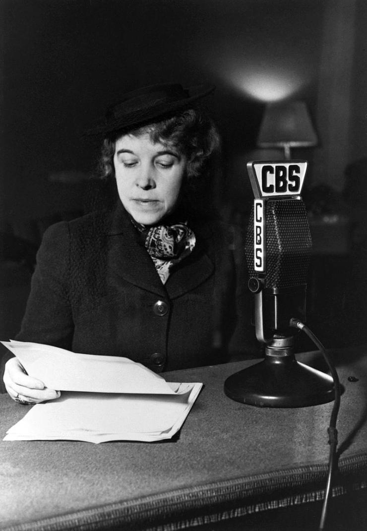 a woman at a microphone