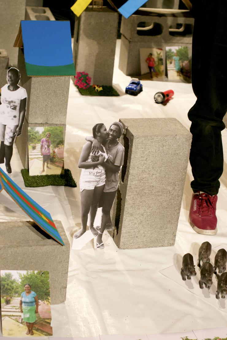 cinderblocks and cut out photos placed onstage to make a theatrical set