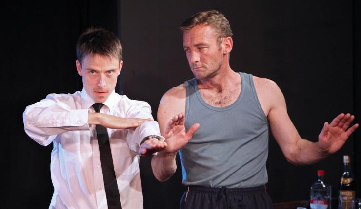 two men dancing onstage