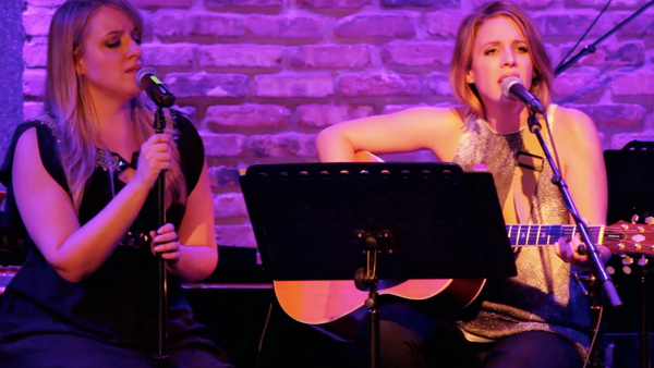 Two performers singing