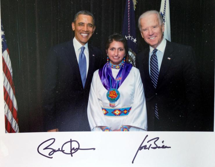 press photo of diane millich with barack obama and joe biden