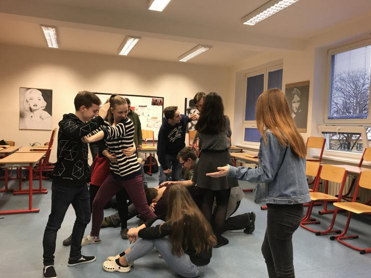 group of students playing a theatre exercise