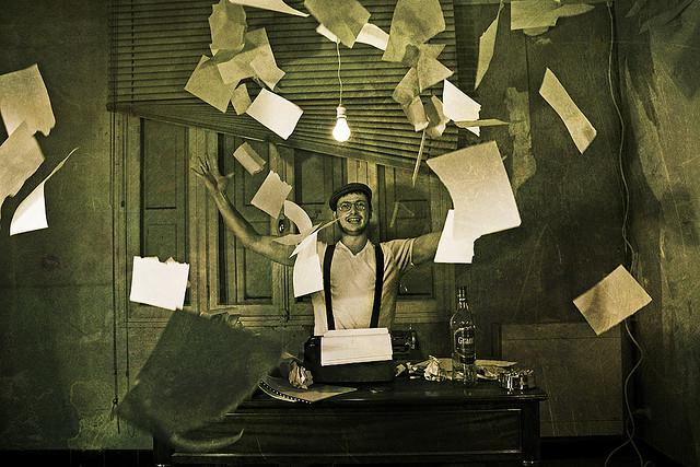 a man tossing pages into the air