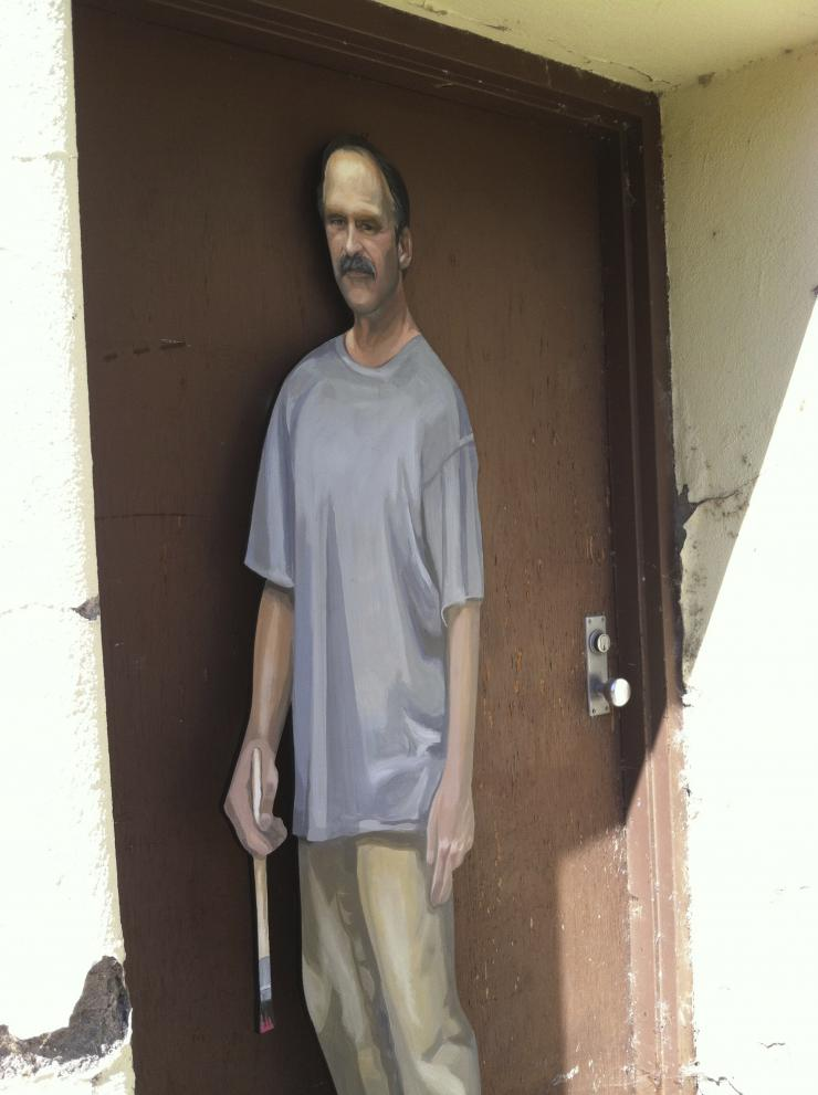 a cardboard cut out of a man