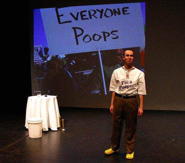 """Actor wearing a shirt which says """"I'm a pooper!"""""""