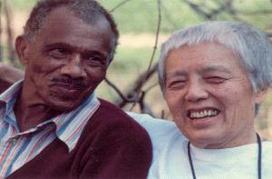 Two men sitting and smiling