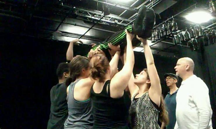 Actors lifting a person